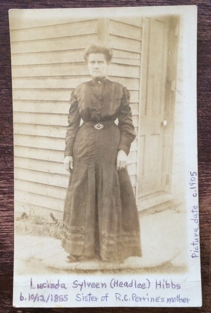 My Grandfather's Aunt Lucinda c. 1905. Appears to be standing at the corner of the store building.