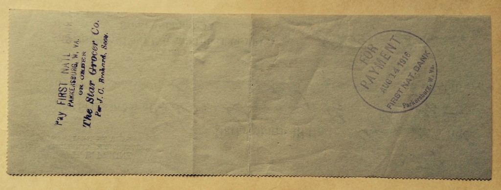 Back of check showing bank stamps.